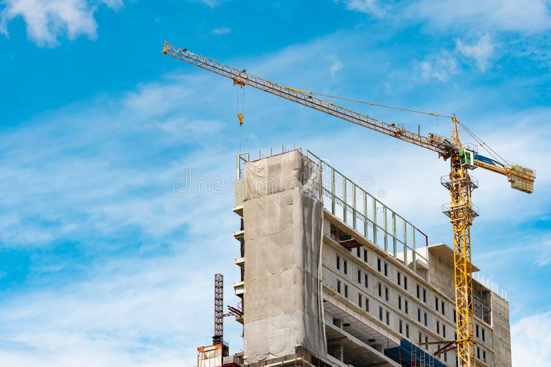 Construction site with crane and building. Real estate industry. Crane use reel lift up equipment in construction site. Building. Made of steel and concrete stock photos