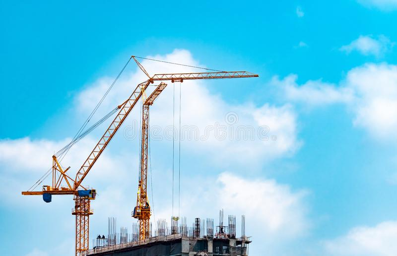 Construction site with crane and building. Real estate industry. Crane use reel lift up equipment in construction site. Building. Made of steel and concrete stock image