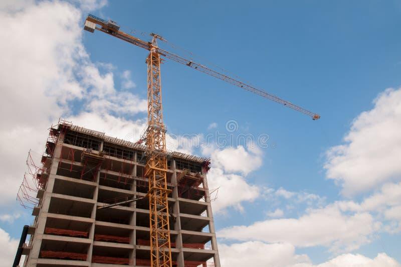 Construction Site and Crane. Horizontal photo of a construction site and crane at daytime stock photo