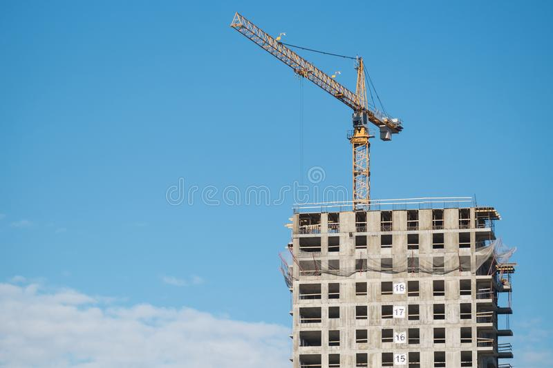 Construction site with crane. Construction site with a lot of incomplete buildings with cranes. Work in progress. New home in future royalty free stock photography
