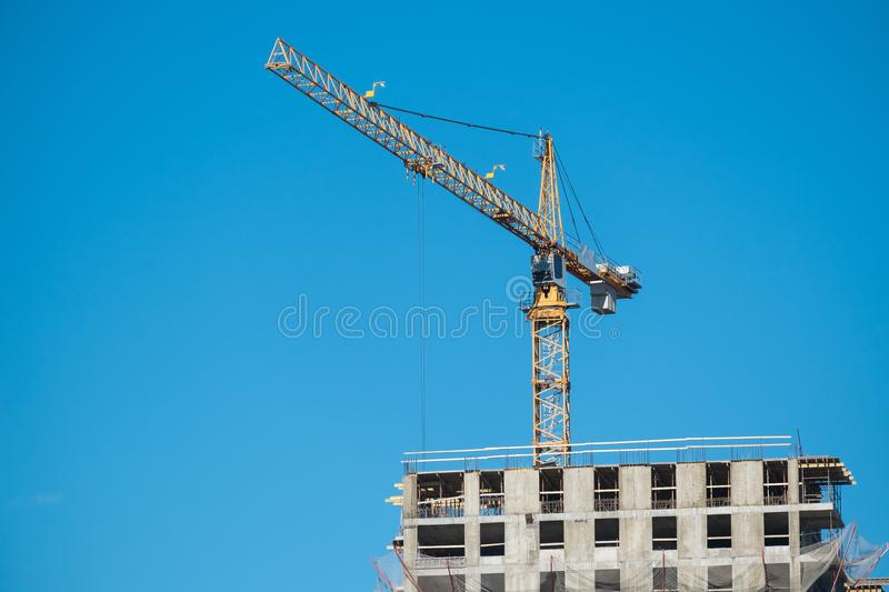 Construction site with crane. Construction site with a lot of incomplete buildings with cranes. Work in progress. New home in future royalty free stock image