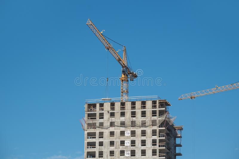 Construction site with crane. Construction site with a lot of incomplete buildings with cranes. Work in progress. New home in future stock photography