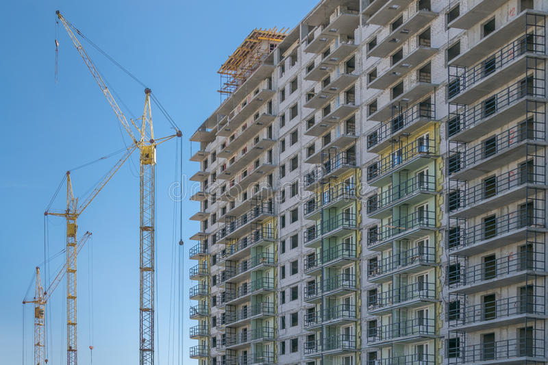 The construction site with cranes and the building stock photography