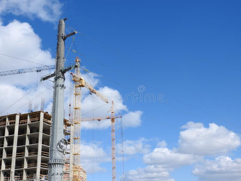 Construction site cranes, work on the construction of the house royalty free stock images