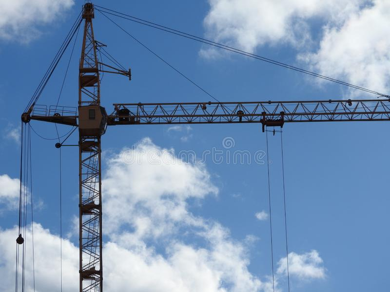 Construction site cranes, work on the construction of the house stock images