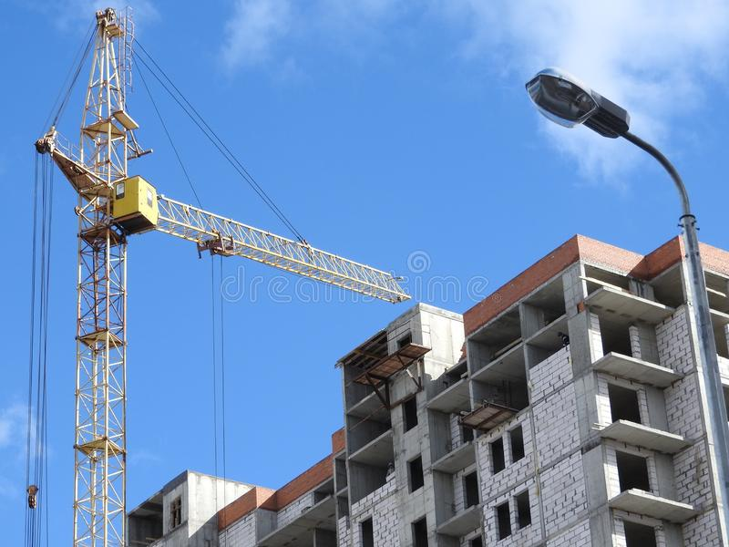 Construction site cranes, work on the construction of the house stock image