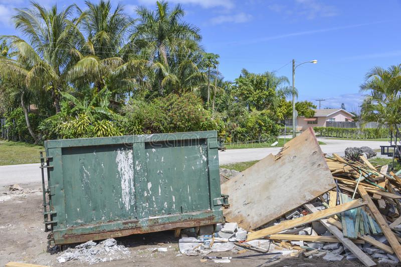Construction site dumpster. Construction job site dumpsters and debris at Boynton Beach, Florida stock photography