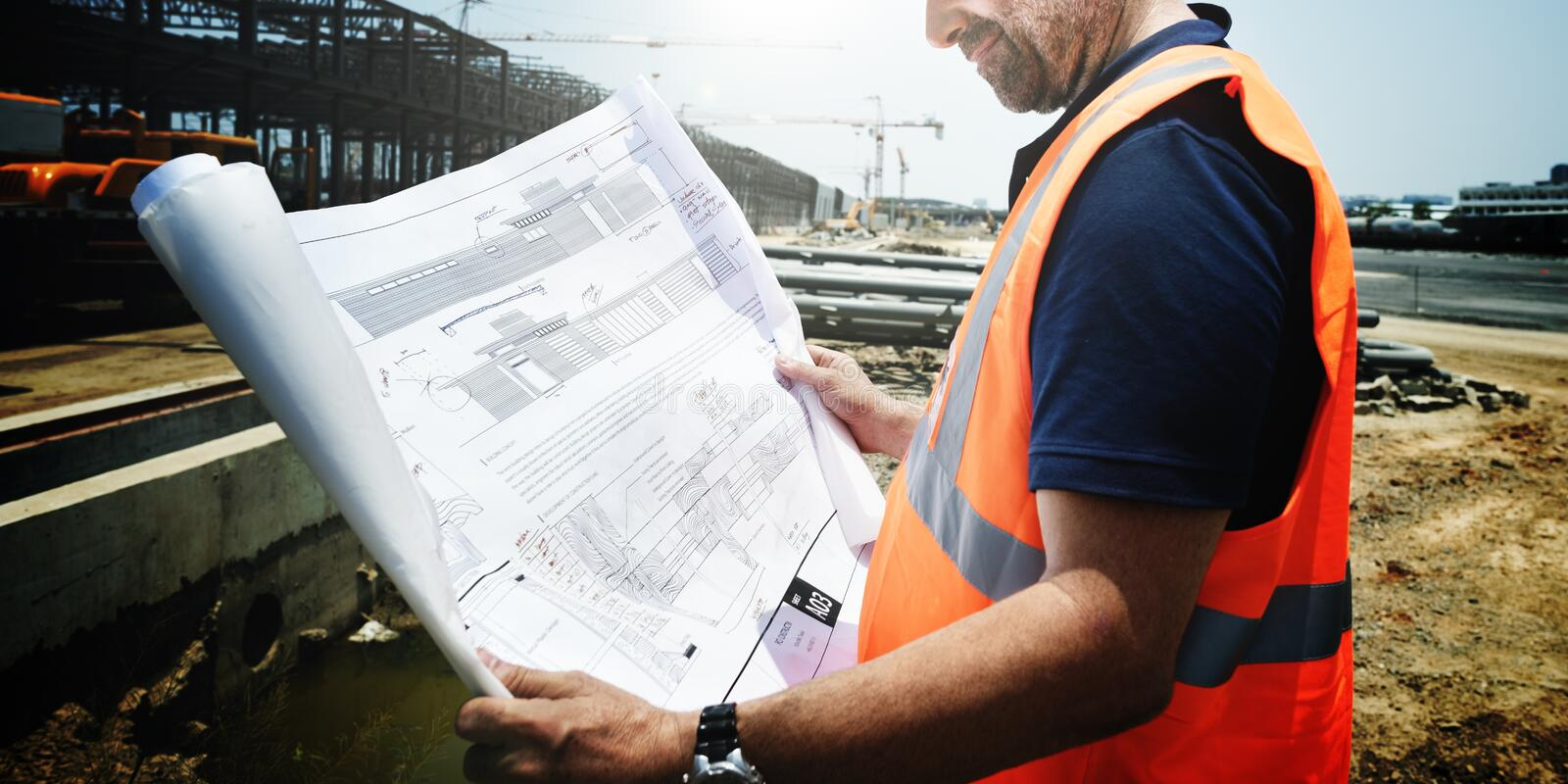 Construction Site Engineer Working Blueprint Concept stock image