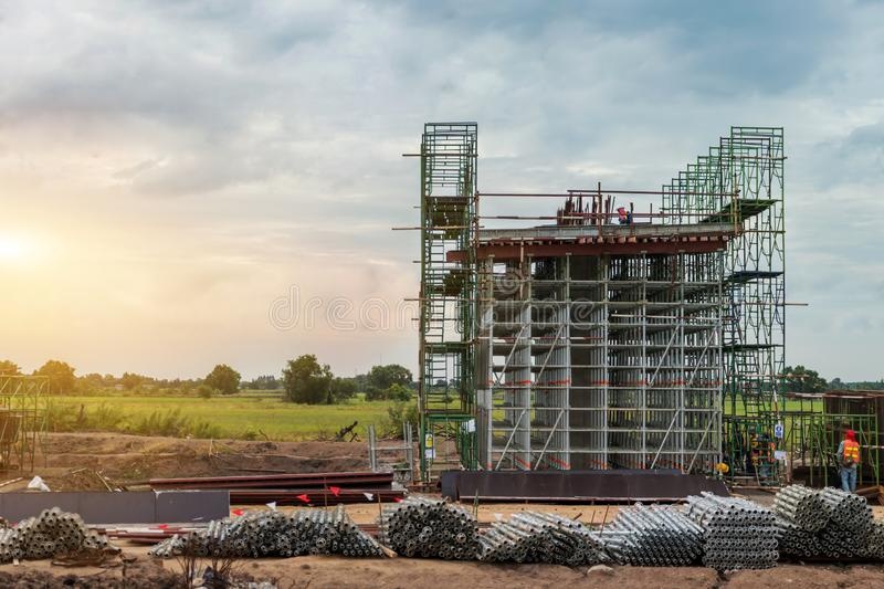 Construction site of the expessway pillar and scaffolding for stucture ,The infrastructure pole of the highway stock image