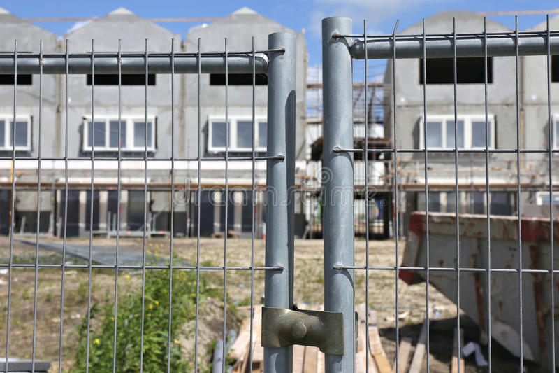 Construction site fence. Protecting townhouse under construction royalty free stock image