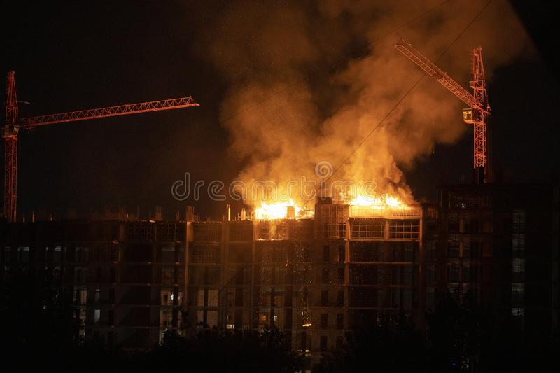Construction site in fire royalty free stock photo
