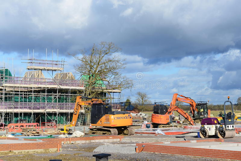 Construction Site. Hilperton, UK - February 21, 2015: Labourers work on a building site. The Wiltshire village is part of the UK`s construction boom with the stock photography