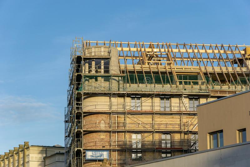 Construction site of a house with scaffolding and new rafter royalty free stock images