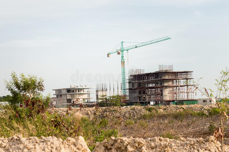 Construction site including several cranes working on a building complex. royalty free stock images