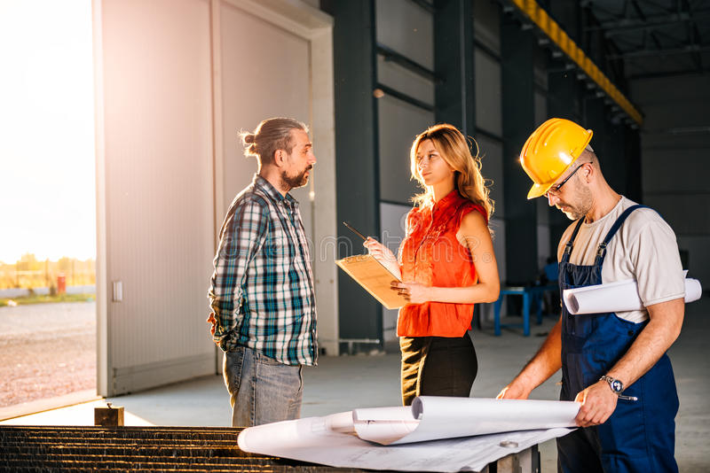 Construction Site Inspector making report stock photography