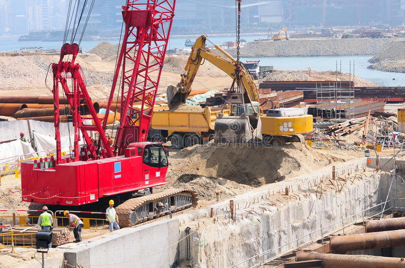 Construction site and land reclamation. Construction site and Victoria Harbour land reclamation replacing Hong Kong historical Star Ferry royalty free stock images