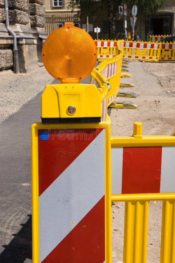 Construction site with lining poles. Construction site with red and white lining poles stock photos