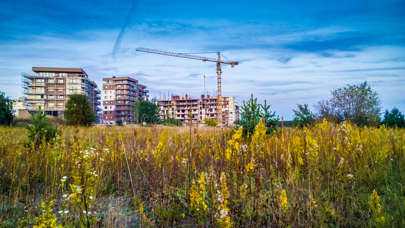 Construction. Site of living accommodations and wild field grass royalty free stock images