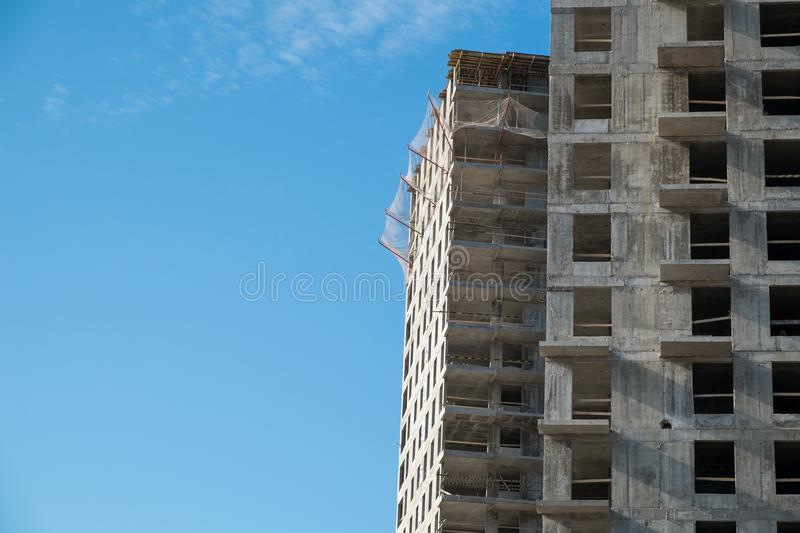 Construction site on blue sky. Construction site with a lot of incomplete buildings with cranes. Work in progress. New home in future stock photography