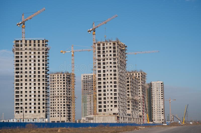 Construction site with crane. Construction site with a lot of incomplete buildings with cranes. Work in progress. New home in future royalty free stock photo