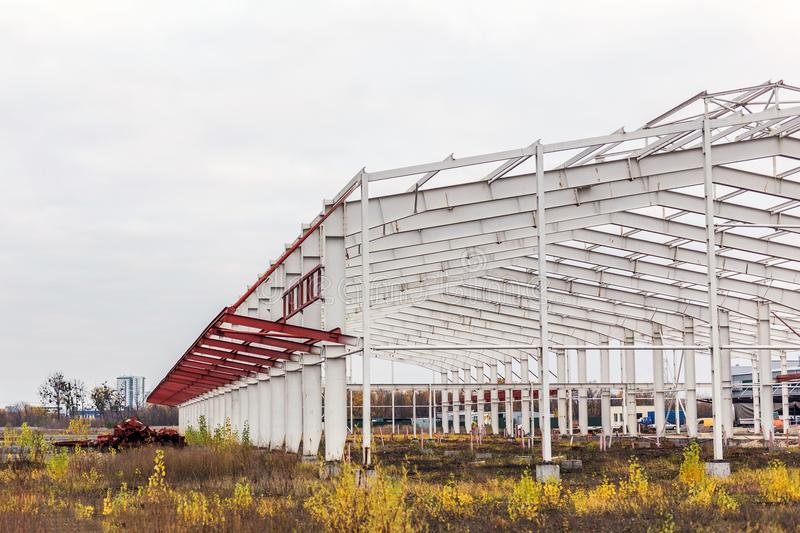 Construction site. Metal structure frame of industrial building stock images