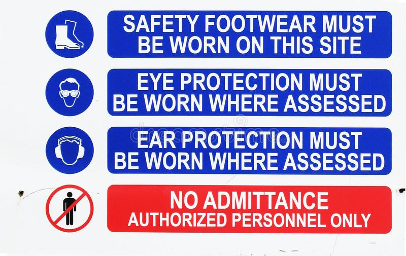 Construction Site Multi Signs. Active construction multi-sign detailing Safety Footwear, Eye Protection, Ear Protection and Authorized Personnel Only Signs stock photos