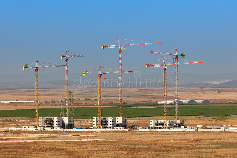 Construction site of new neighborhood. Voew of cranes on construction site of new neighborhood in Kiryat Gat, Israel royalty free stock photos
