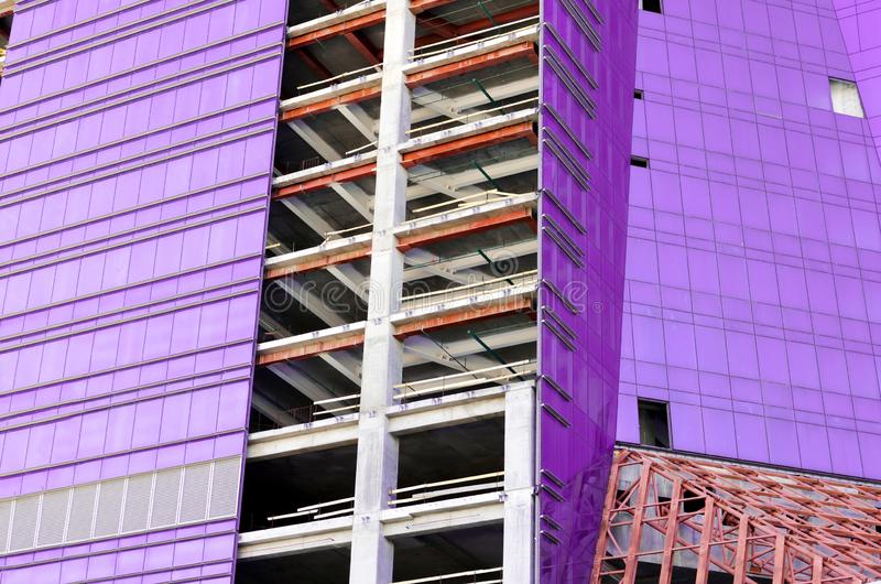 Construction site. production of apartment buildings. construction of an office building in the city. Purple windows royalty free stock photos