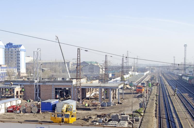 Construction site of the railway station. Truck cranes, workers and construction materials.  royalty free stock photo