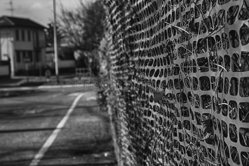 Construction site with safety orange fence, monochrome. For web site or mobile devices royalty free stock image