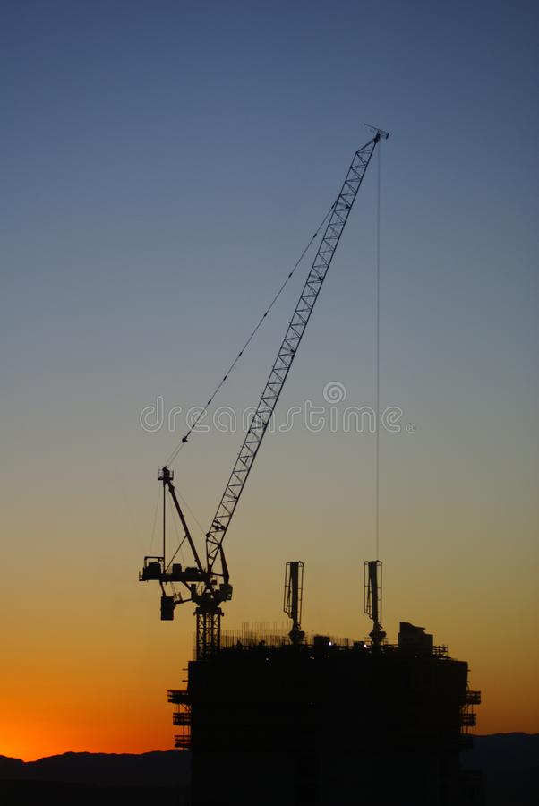 Construction site at sunrise stock photo