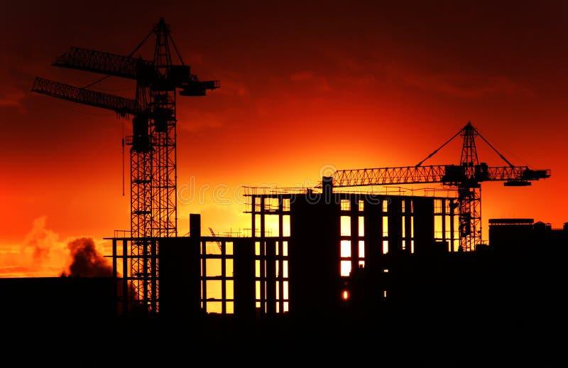 Construction site at orange sunset royalty free stock photo