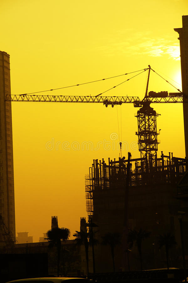 Construction site on sunset. Heavy equipment and construction site on sunset background stock photo