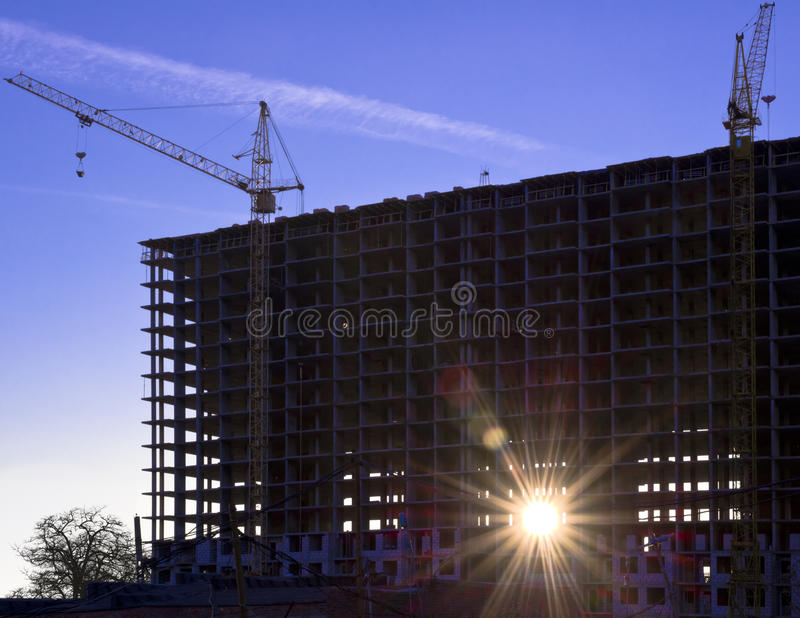 Construction site at sunset.  royalty free stock photography