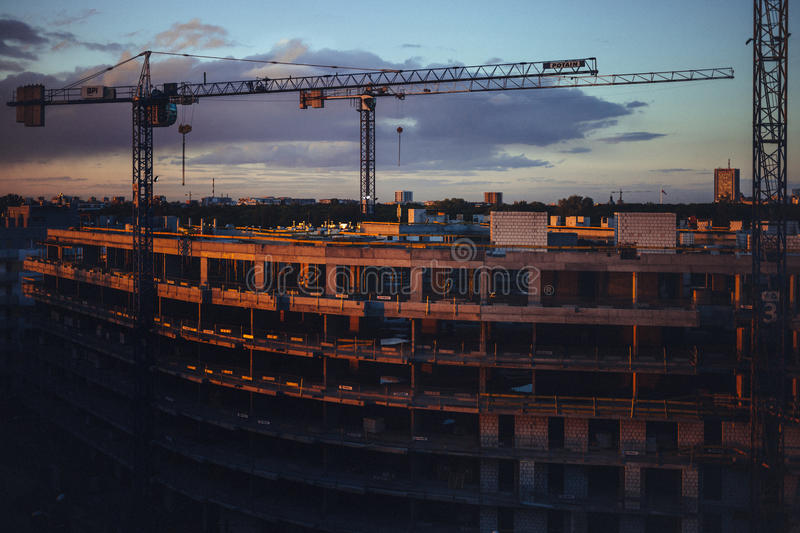 Construction site at sunset stock images