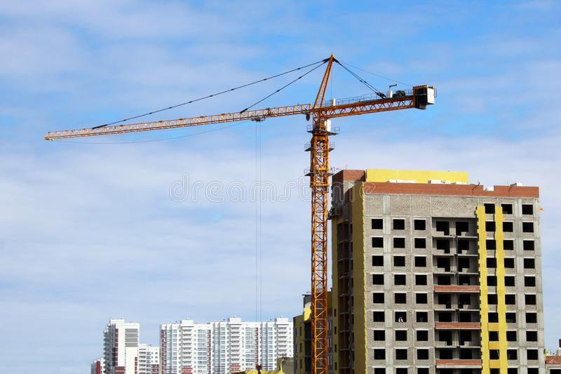 Construction site tower cranes against blue sky stock photos