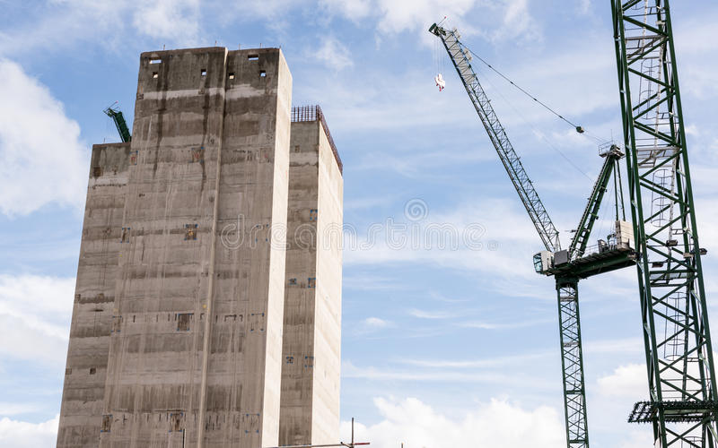 Construction site with two big cranes and concrete core of new s. Kyscraper under construction stock photography