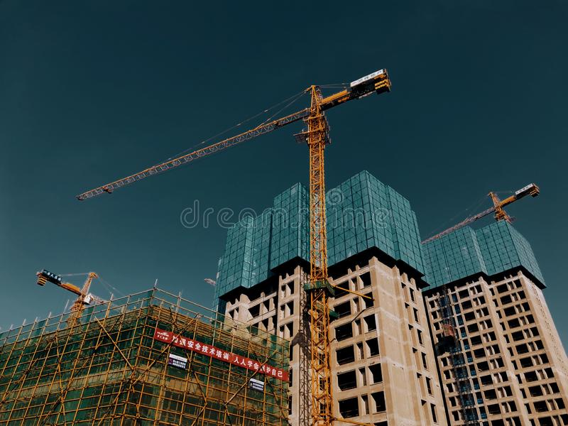 Construction site of a unfinished commercial residential apartments in Wuhan china. Construction site of a unfinished commercial residential apartments under royalty free stock images