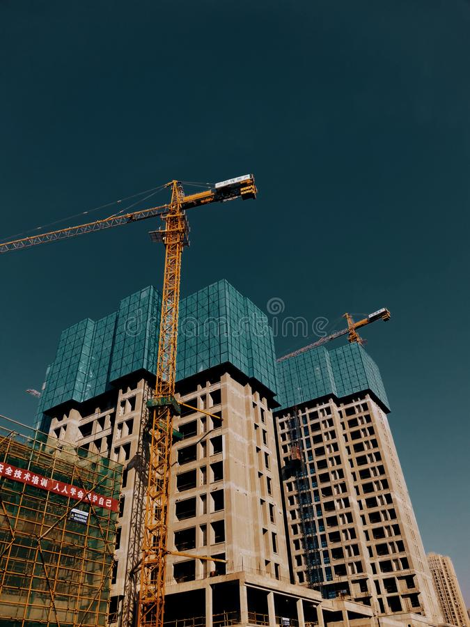 Construction site of a unfinished commercial residential apartments in Wuhan china. Construction site of a unfinished commercial residential apartments under royalty free stock photo