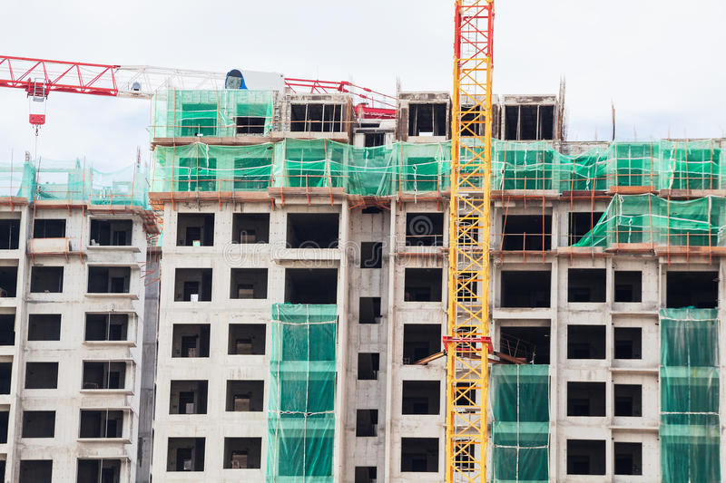 Construction site view of crane, lift, metal beam, brick, metal ladder and concrete royalty free stock images