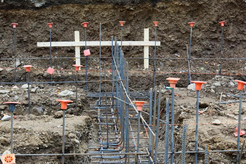 Construction site view looking down footings with gridwork of rebar royalty free stock images