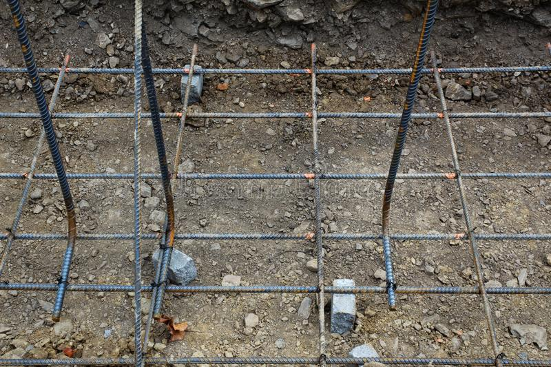 Construction site view of steel rebar grid for foundation royalty free stock image