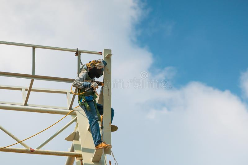 In the construction site, the welding workers at work Work on hi royalty free stock image