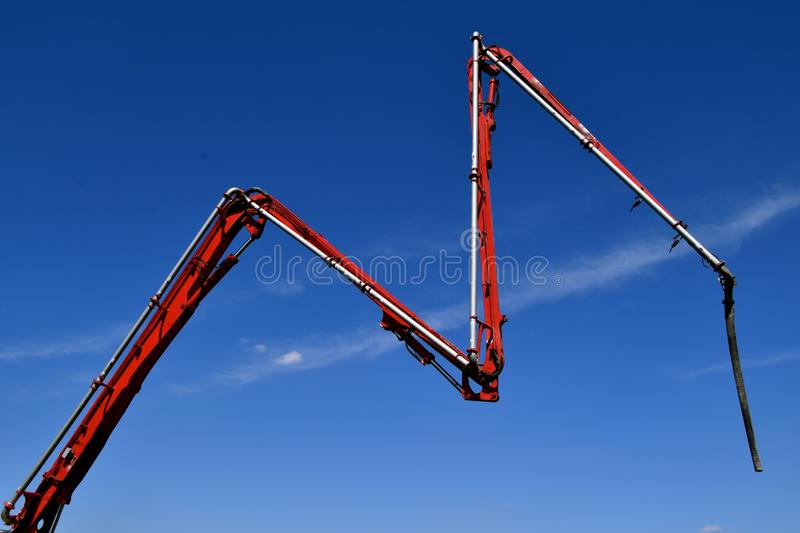 Construction site with wet mud concrete being supplied stock photo