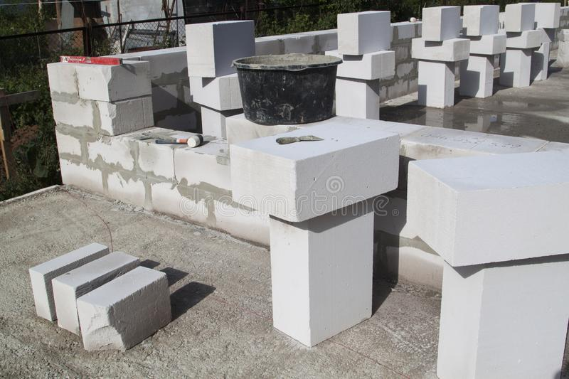 Construction site on which the walls are built of gas concrete blocks. Brick, cement, home, work, house, equipment, industry, industrial, bricklayer, aerocrete stock images