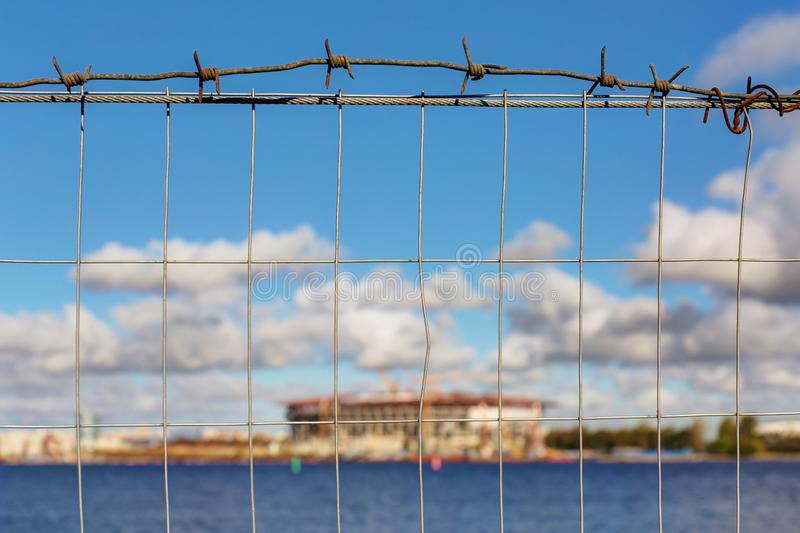 Construction site through a wire fence. View of the construction site through a wire fence stock images