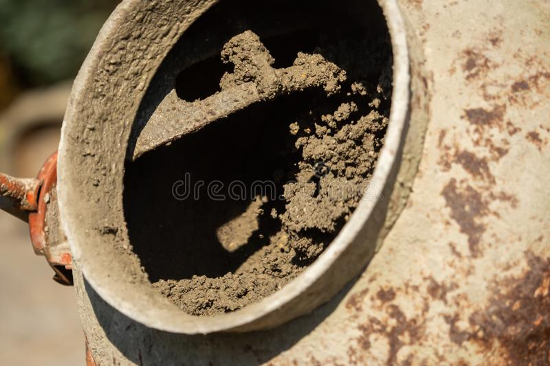 Construction site work with concrete mixer and wheelbarrows royalty free stock photos