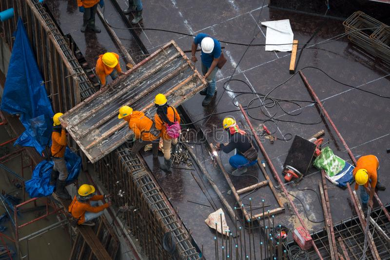 Construction site workers - aerial - Top View stock images