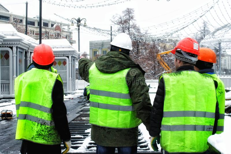 Construction site workers stock photos