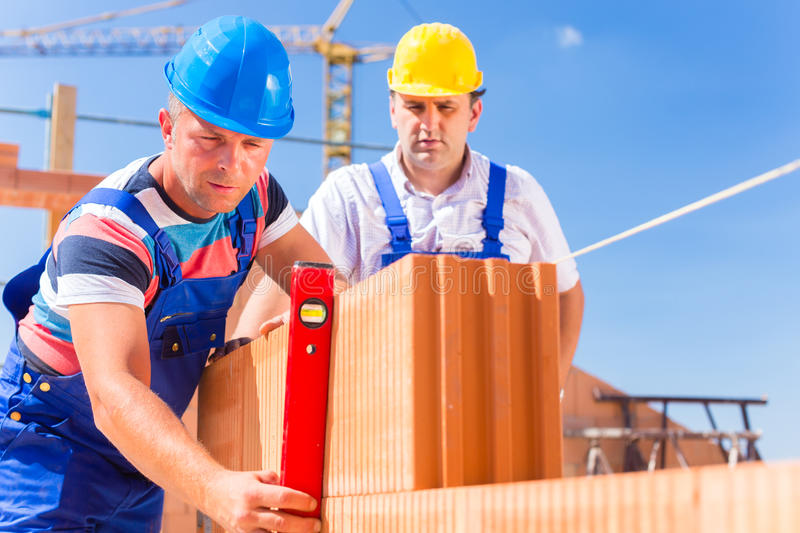 Construction site workers checking building shell stock photo